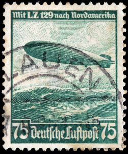 A stamp from pre-WWII Germany depicting an airship over water.