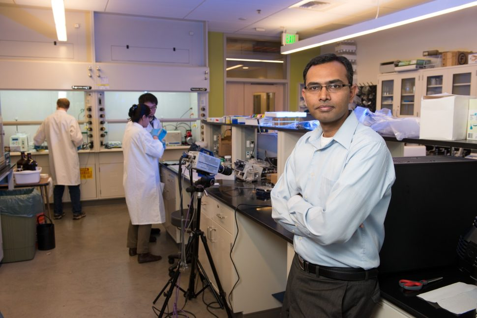 Arun Kota, Assistant Professor of Mechanical Engineering, studies coatings in his lab in the Scott Bioengineering Building. July 2, 2014 | CSUventures.org