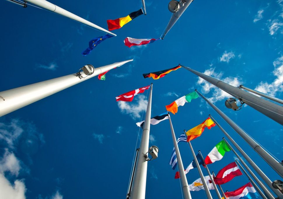 Bottom-up shot of the flags of member nations in the European Union | Botond Horvath | Shutterstock.com