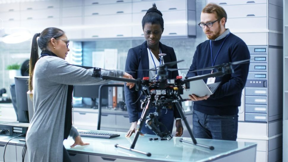 A diverse group of drone developers in the lab | Gorodenkoff | Shutterstock.com