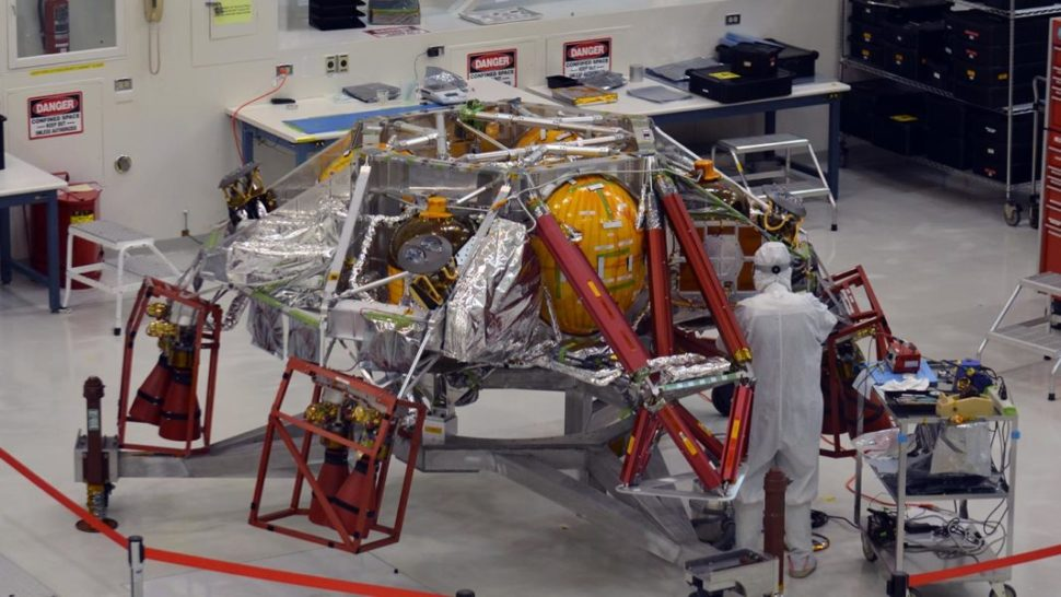 A technician works on the descent stage for NASA's Mars 2020 mission inside JPL's Spacecraft Assembly Facility | JPL | JPL.NASA.gov