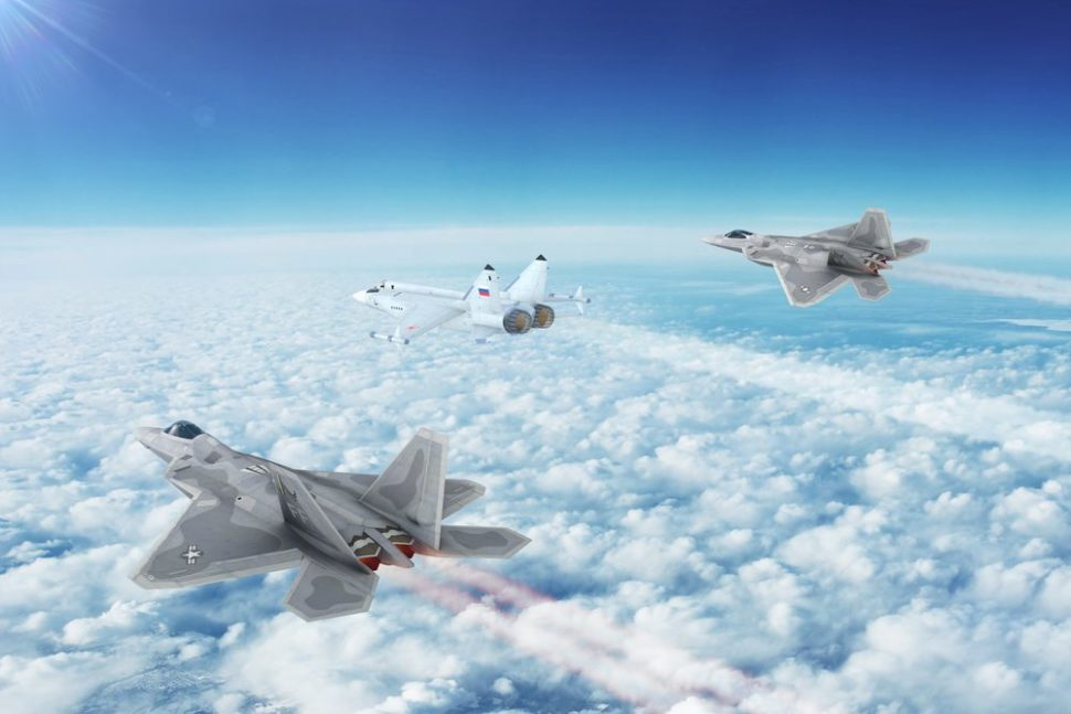 Two very stealthy F-22 Raptors surrounding a Russian MIG. | NextNewMedia | Shutterstock.com