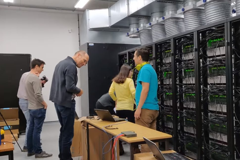 Steve Furber and his team while putting together the neuromorphic supercomputer SpiNNaker. | Screen grab from iProgrammerTV | Youtube.com