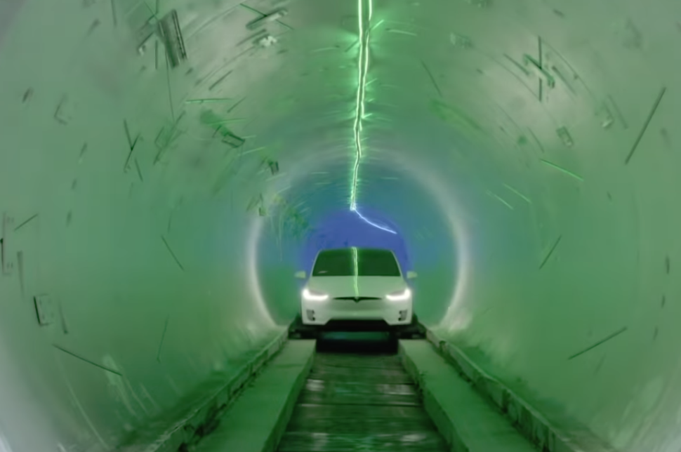 A Tesla Model X during a demonstration along the track of the first Hyperloop tunnel in Hawthorne City, California| The Boring Company