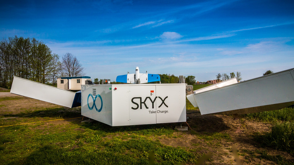 The SkyOne, SkyX's Vertical Take-Off and Landing (VTOL) UAV, seen sitting on an xStation which helps the UAV remotely charge to perform diagnostics in a more autonomous fashion. | PR Newswire