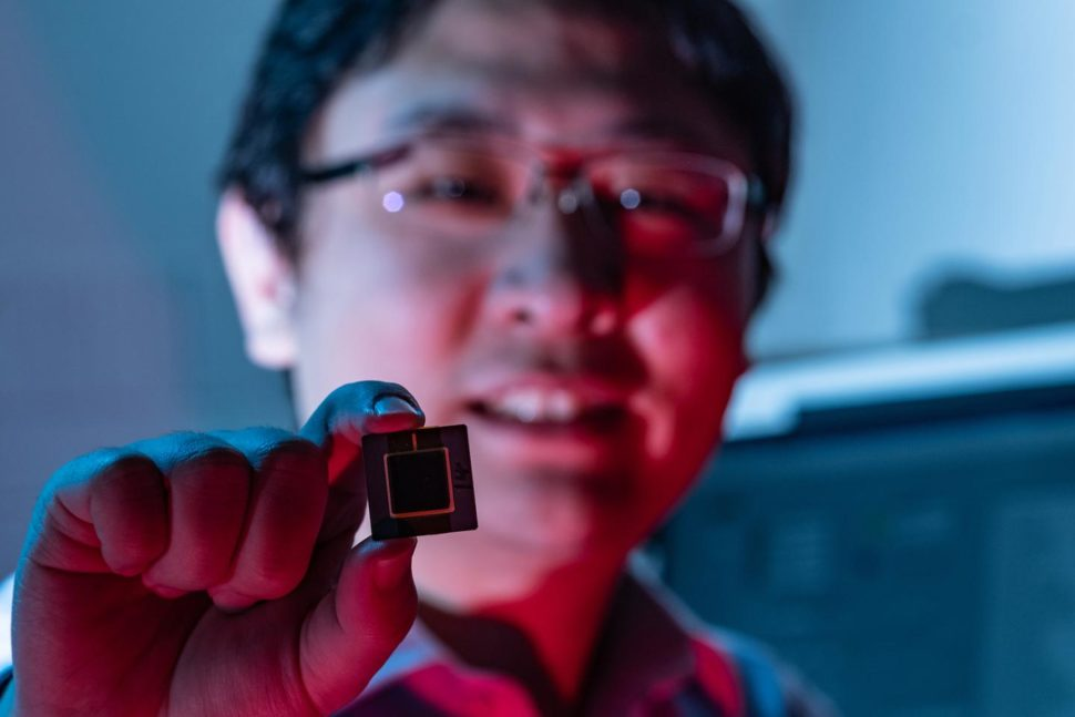 Kaiyuan Yang holding a prototype of the new security feature he and his partner created for IoT devices | Jeff Fitlow/Rice University
