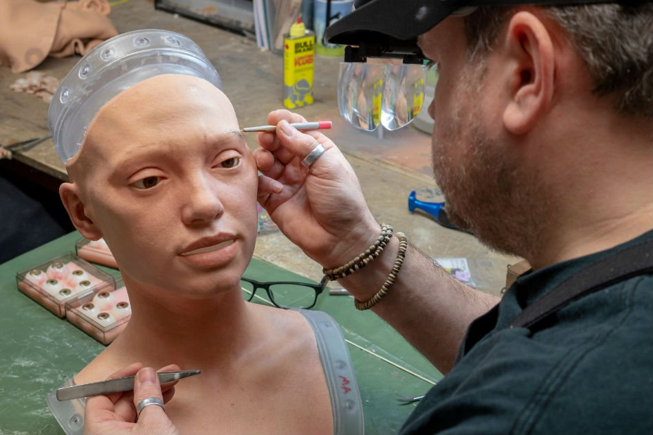 Engineered Arts specialist Mike Humphrey working on a rubberized head of the worlds first robot artist Ai-Da   Image courtesy of REUTERS/Matthew Stocks