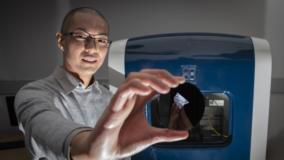 Dr. Sherman Wong With the New Type of Silicon | Image Credit: ANU